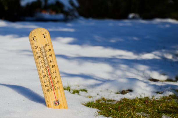 thermometer in melting snow, spring is coming temperature measurement in spring time, ending winter melting stock pictures, royalty-free photos & images
