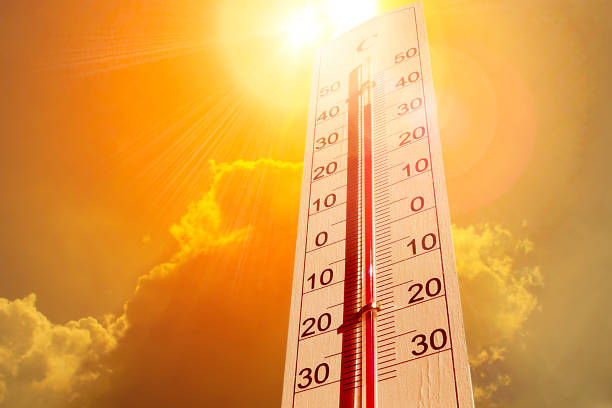 Thermometer in the sky, the heat stock photo