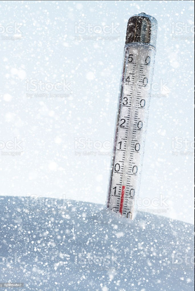 Thermometer in the snow and it is a snowing weather stock photo