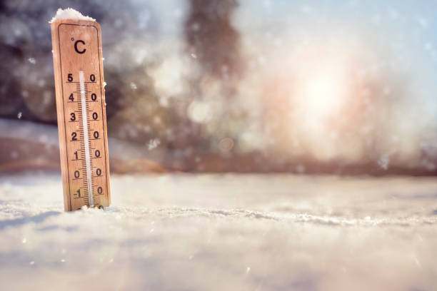 thermometer in the snow - weather stock photos and pictures