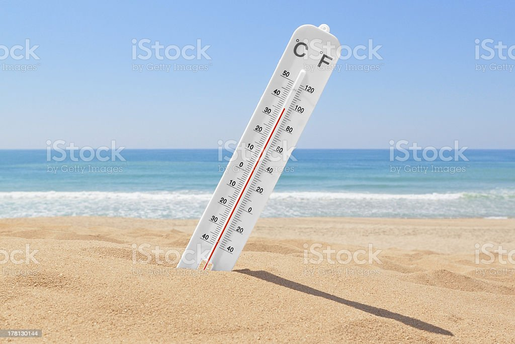 Thermometer on beach near sea stock photo
