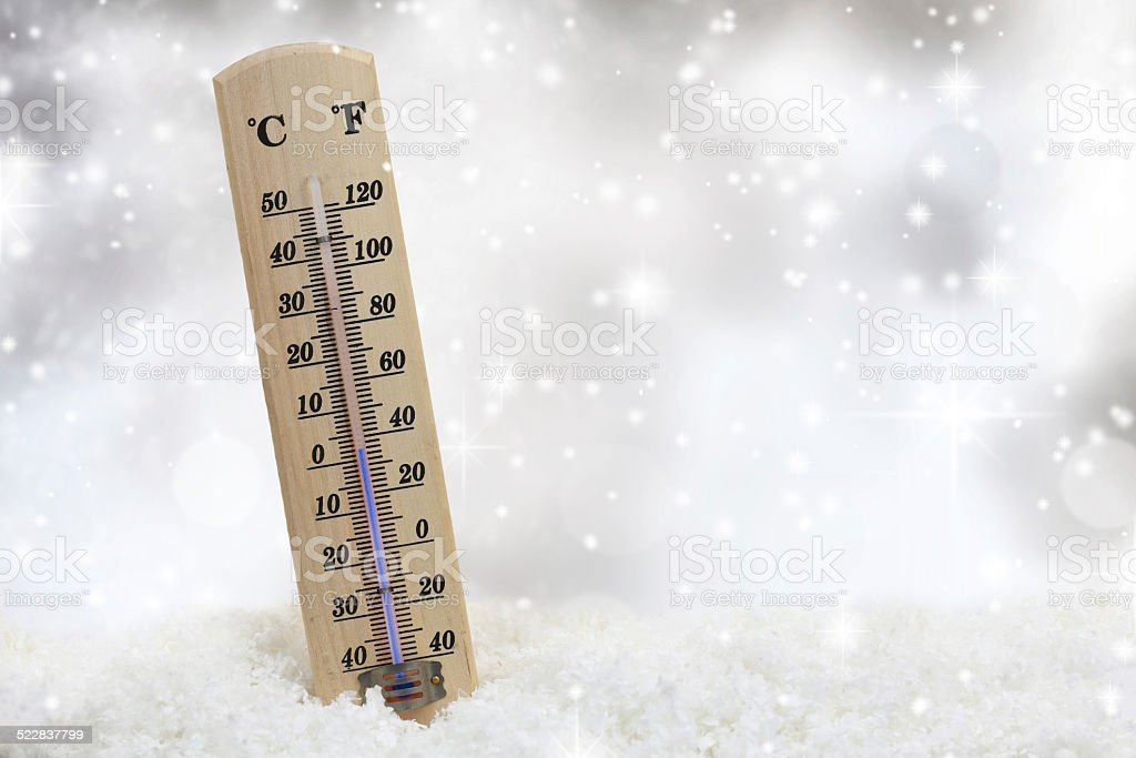 Thermometer on snow shows low temperatures stock photo