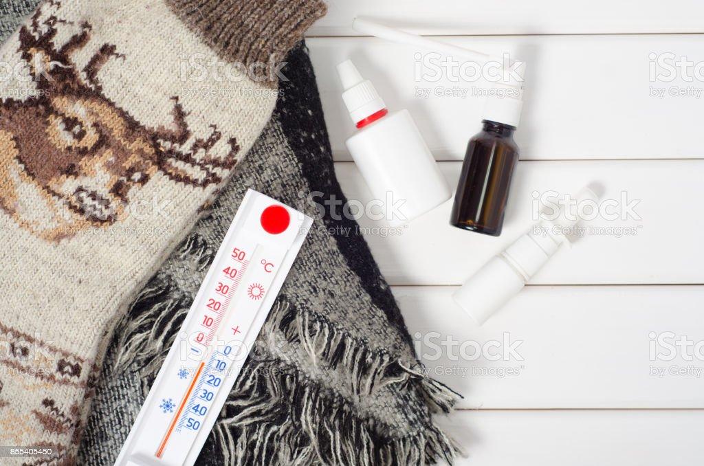 Thermometer socks scarf medicine stock photo