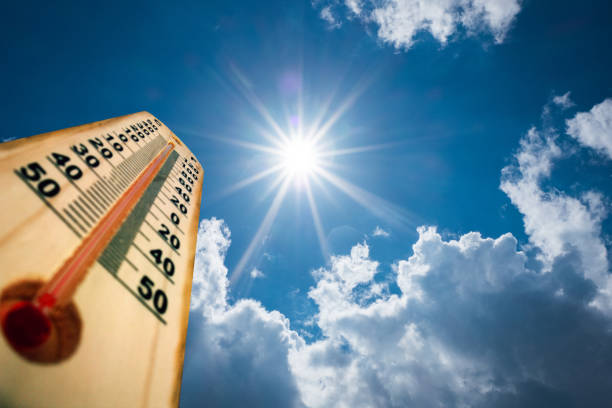 thermometer sun high degres. hot summer day. high summer temperatures - weather stock photos and pictures