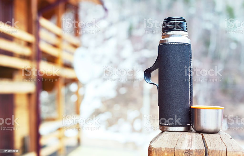 thermos and thermo cup outdoors stock photo