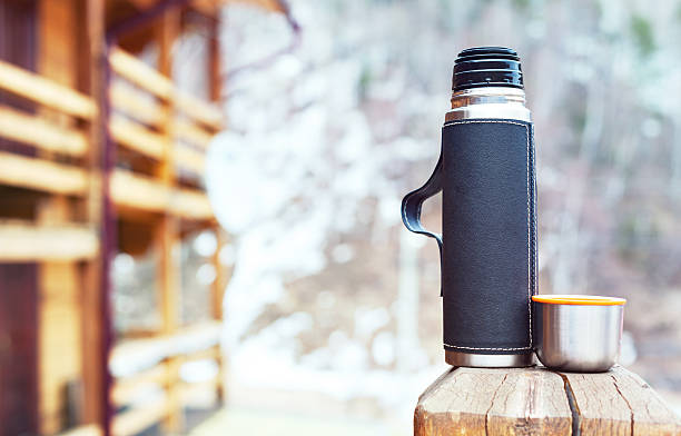 thermos and thermo cup outdoors - flask stock photos and pictures