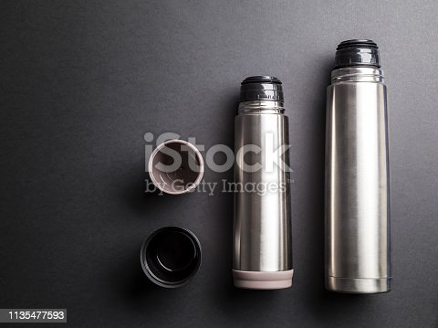 1135476970istockphoto Thermoses organized over black background 1135477593