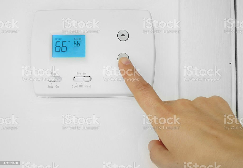 thermostat adjustment stock photo