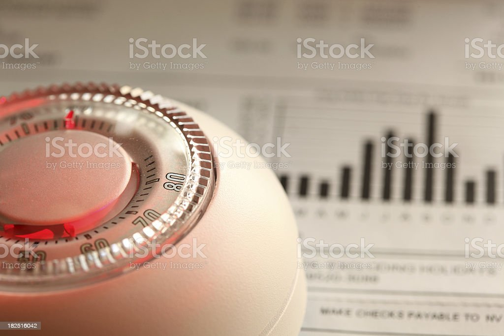 Thermostat and bill royalty-free stock photo