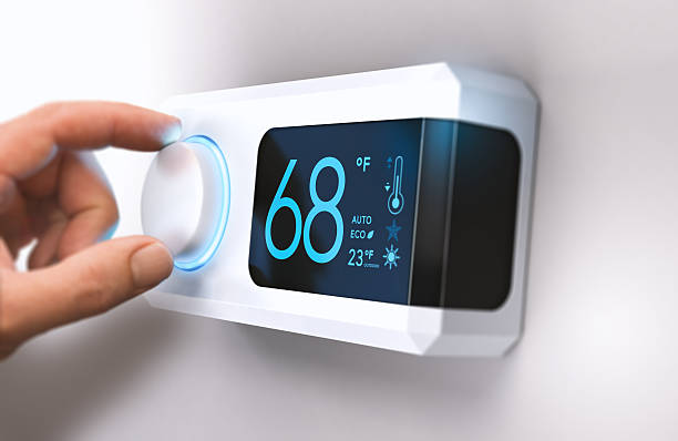 thermostat, home energy saving - warm house stock photos and pictures