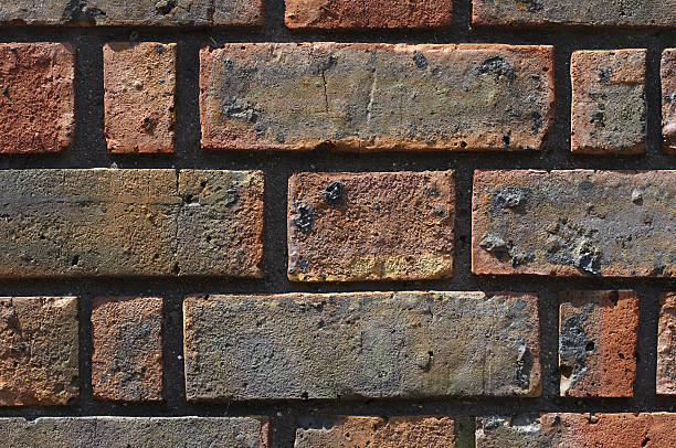 red london brick textured add graffiti - whiteway graffiti stock photos and pictures