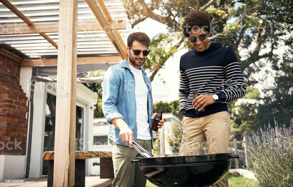 These bros know how to grill up a storm stock photo