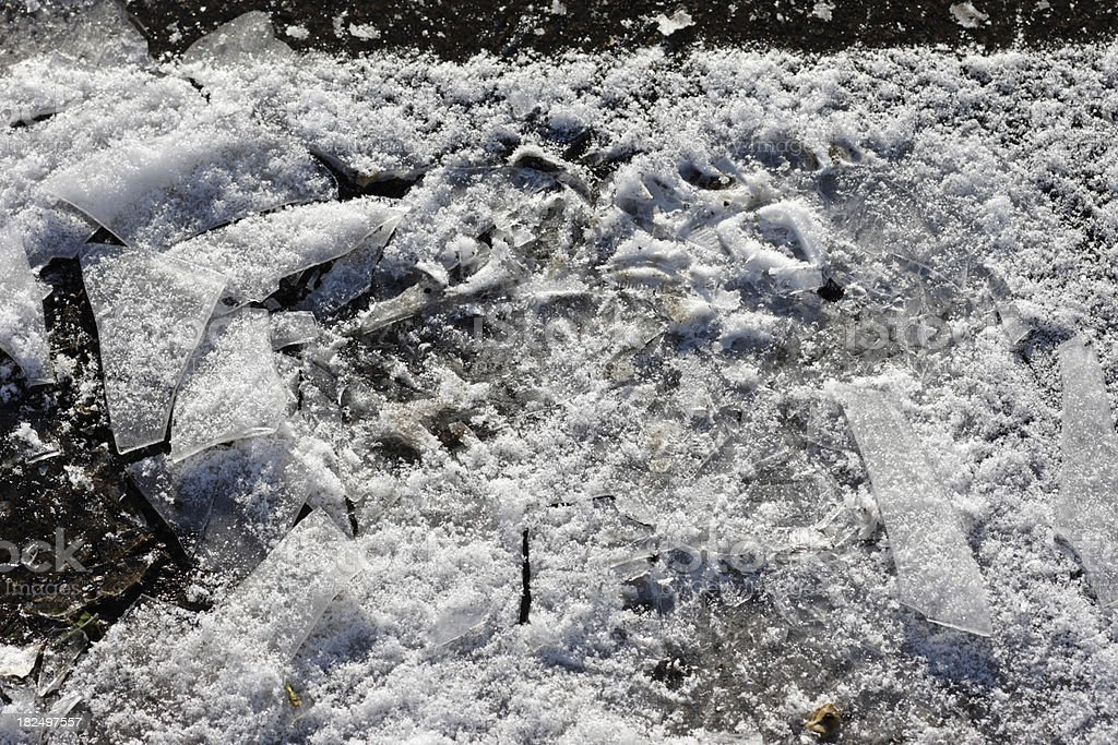 Bootprint in ice puddle broken to shards royalty-free stock photo
