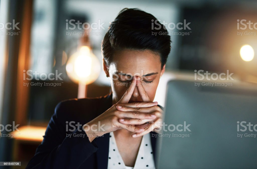 These long hours are draining all the energy from me stock photo