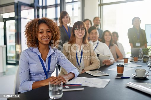 Cropped shot of an attractive young businesswoman giving a presentation in the boardroom