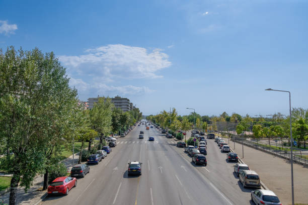 Thessaloniki, Greece - August 31 2019: city road traffic on a multi lanes avenue. Elevated day sunny view of Leoforos Megalou Alexandrou with passing cars. stock photo