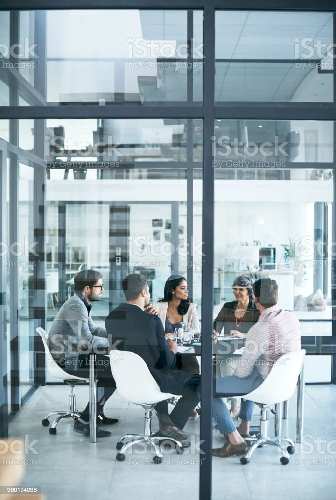 They all have top ideas to share around the table stock photo