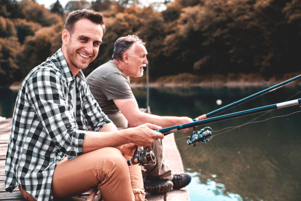 They are geared to catch fish They are geared to catch fish freshwater fishing stock pictures, royalty-free photos & images