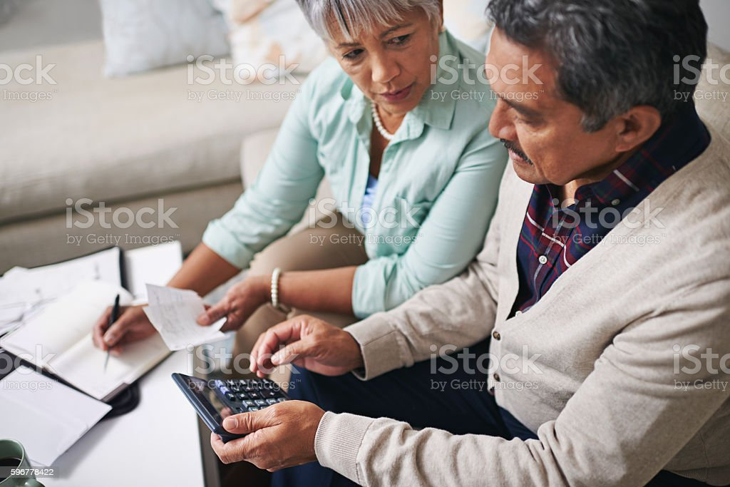 They believe in keeping track of all their expenses stock photo