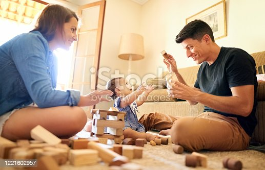 872316662 istock photo They both always have time to play with her 1221602957