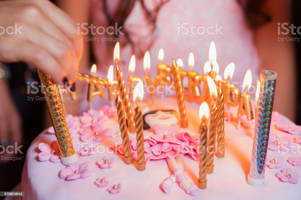 They Burn Candles On The Birthday Blurred Cake With Lights Background Royalty