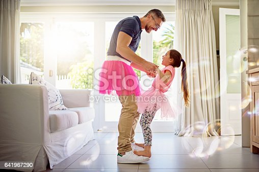 Shot of a happy father and daughter dancing together at home