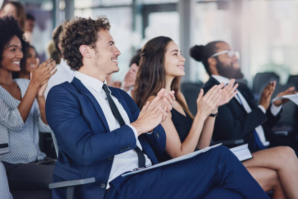They don't just applaud for anything Low angle shot of a group of businesspeople applauding during a seminar in the conference room conference event stock pictures, royalty-free photos & images