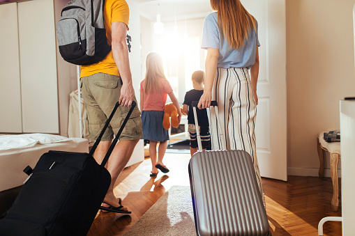 Shot of a happy family leaving their home for a vacation