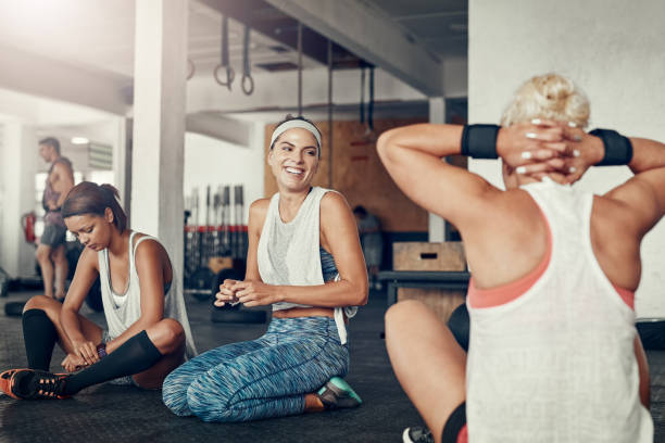 They enjoy hanging out as much as working out too stock photo