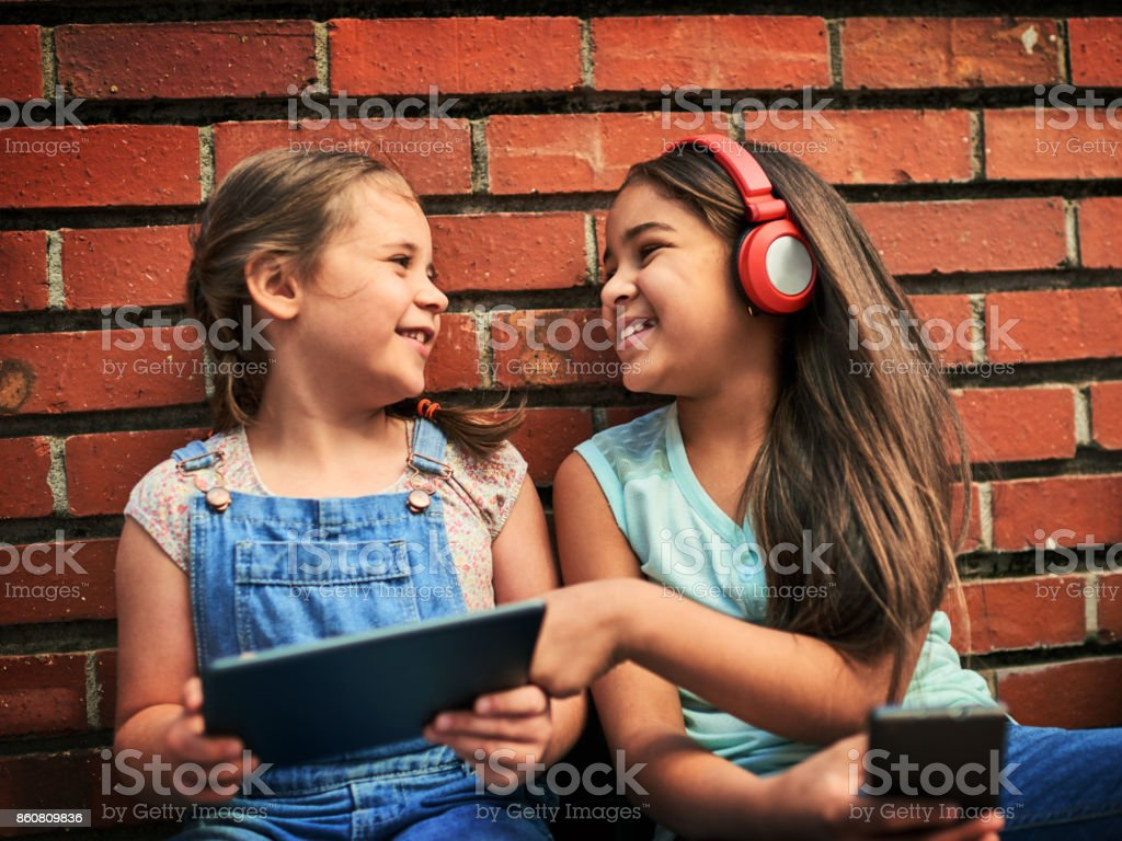 They Enjoy Watching Funny Videos Together Stock Photo