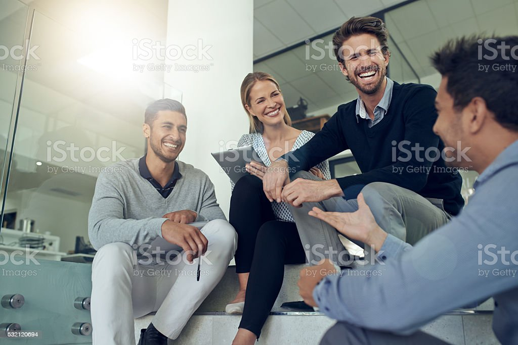 They have a lot of in jokes in this office stock photo