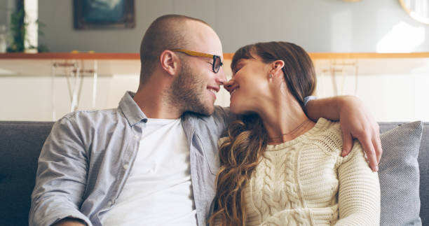 they just can't get enough of kissing each other - brunette woman eyeglasses kiss man foto e immagini stock