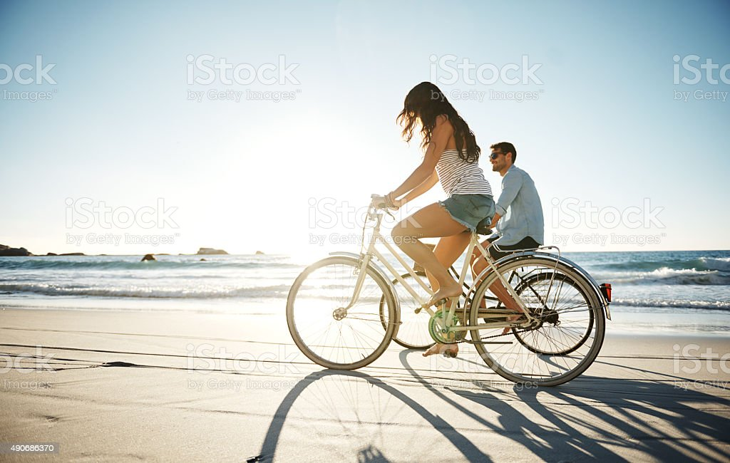 They love long rides on the beach stock photo