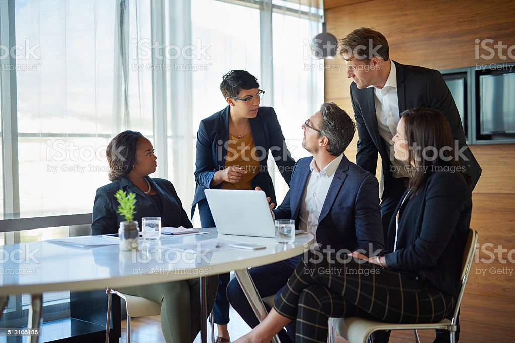 They rely on their ability to function as a team Shot of a group of corporate businesspeople working in the boardroomhttp://195.154.178.81/DATA/i_collage/pi/shoots/806413.jpg Adult Stock Photo