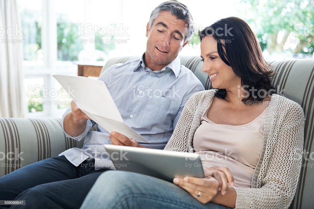They share the responsibilities in their marriage stock photo