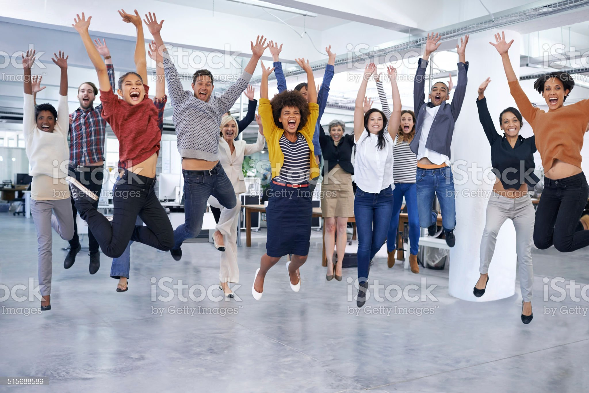 They'll jump at the chance to help you out Shot of office staff jumping Celebration Stock Photo