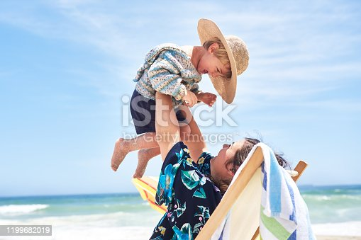 Shot of a mother bonding with her little son at the beach