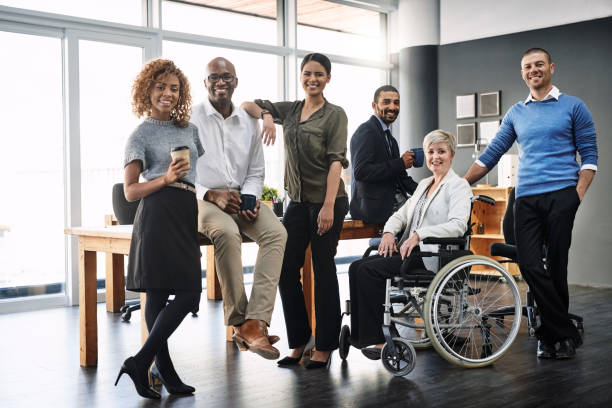 They're a diverse and dynamic team Portrait of a group of businesspeople in an office multi ethnic group stock pictures, royalty-free photos & images
