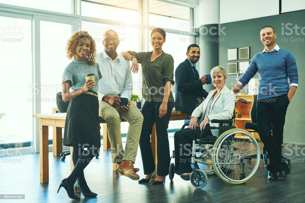 They're a diverse and dynamic team Portrait of a group of businesspeople in an office Adult Stock Photo