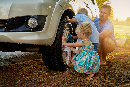 Theyre Always Eager To Help Dad Wash The Car Stock Photo ...