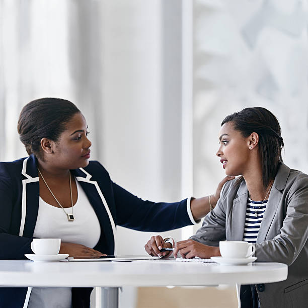 They're coworkers and friends stock photo