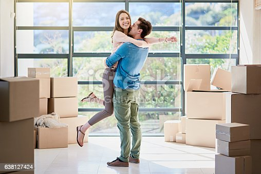 Shot of a young couple celebrating their move into a new home