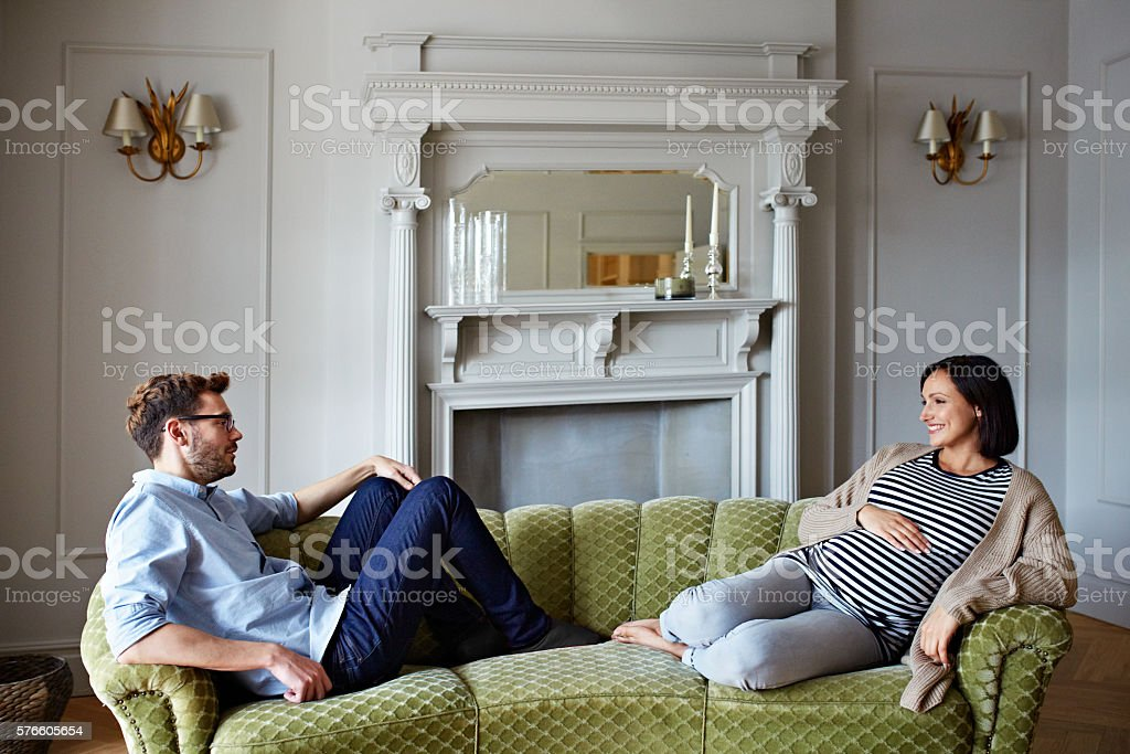 They're going to be parents any day now stock photo