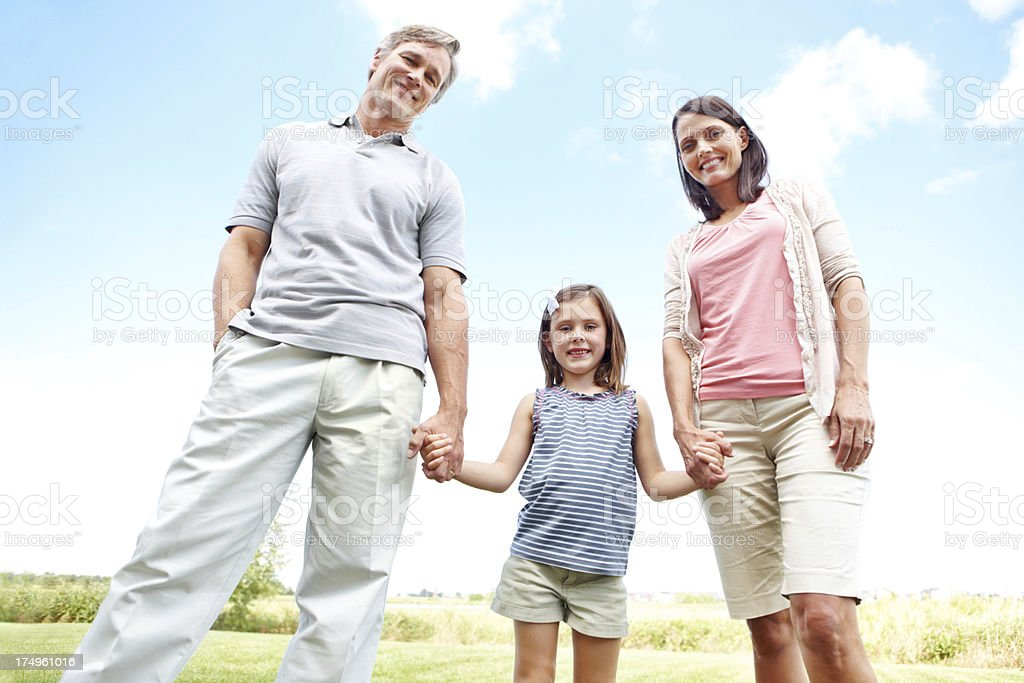 They're her guiding pillars through childhood royalty-free stock photo