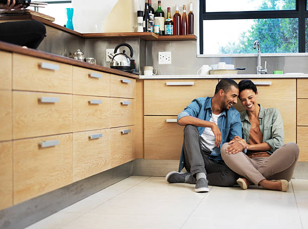 they're home is filled with love and laughter - sitting on floor stock photos and pictures