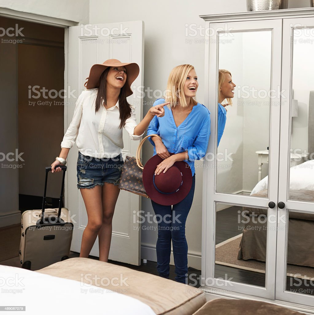 They're impressed with their room stock photo