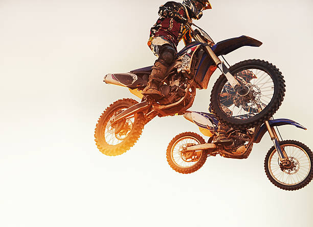 they're neck-a-neck - motorbike racing stock photos and pictures
