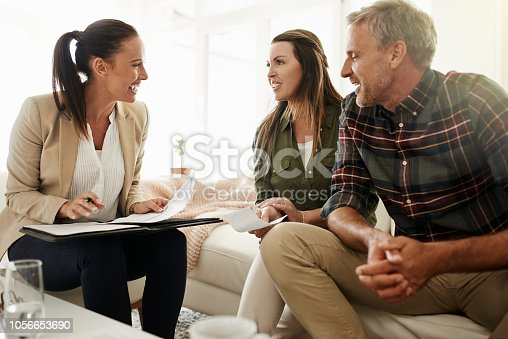 Shot of a mature couple getting advice from their financial consultant at home