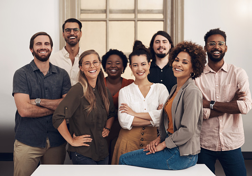 Portrait of a group of businesspeople standing together in an office