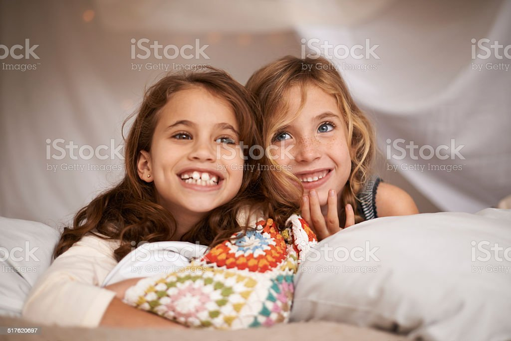 They've been looking forward to this sleepover! stock photo